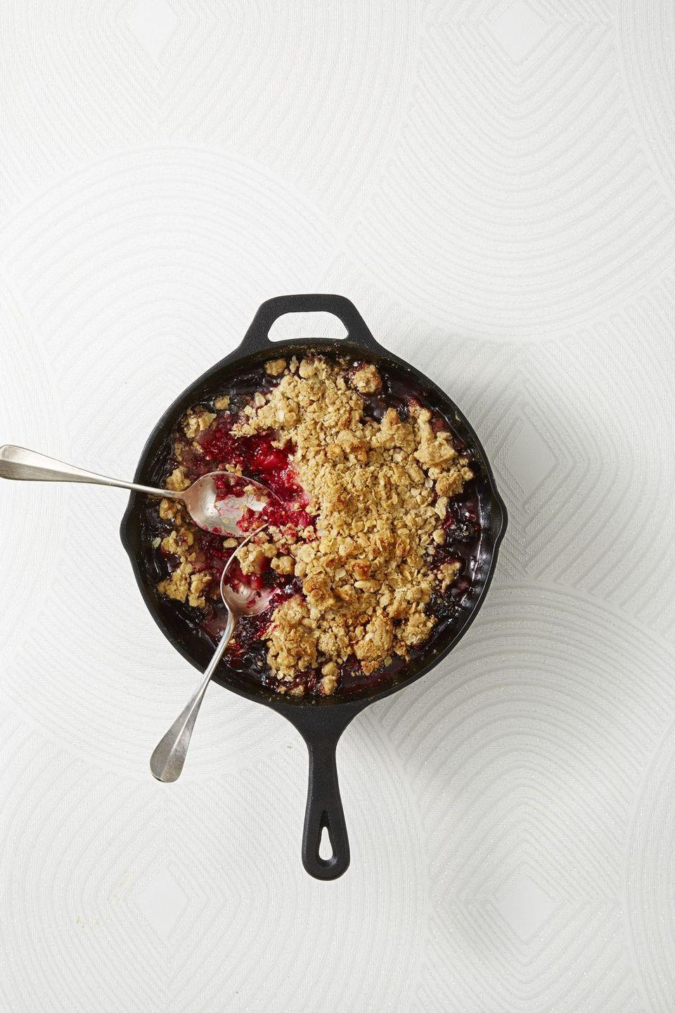 """<p>A crispy, buttery crumble, made with oats and walnuts, tops this dessert recipe's spiced-to-perfection berry insides.</p><p><em><a href=""""https://www.goodhousekeeping.com/food-recipes/dessert/a42825/spiced-pear-berry-crumble-recipe/"""" rel=""""nofollow noopener"""" target=""""_blank"""" data-ylk=""""slk:Get the recipe for Spiced Pear and Berry Crumble »"""" class=""""link rapid-noclick-resp"""">Get the recipe for Spiced Pear and Berry Crumble »</a></em></p>"""