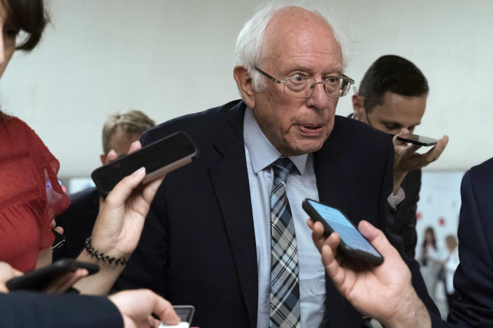 Sen. Bernie Sanders, I-Vt., talks to reporters as he walks to the senate chamber ahead of a test vote scheduled by Democratic Leader Chuck Schumer of New York on the bipartisan infrastructure deal senators brokered with President Joe Biden, on Capitol Hill, in Washington, Wednesday, July 21, 2021. Republicans prepared to block the vote by mounting a filibuster over what they see as a rushed and misguided process. (AP Photo/Jose Luis Magana)