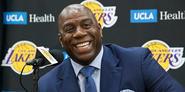 "Magic Johnson and the <a class=""link rapid-noclick-resp"" href=""/nba/teams/lal"" data-ylk=""slk:Los Angeles Lakers"">Los Angeles Lakers</a> got their man. (AP)"