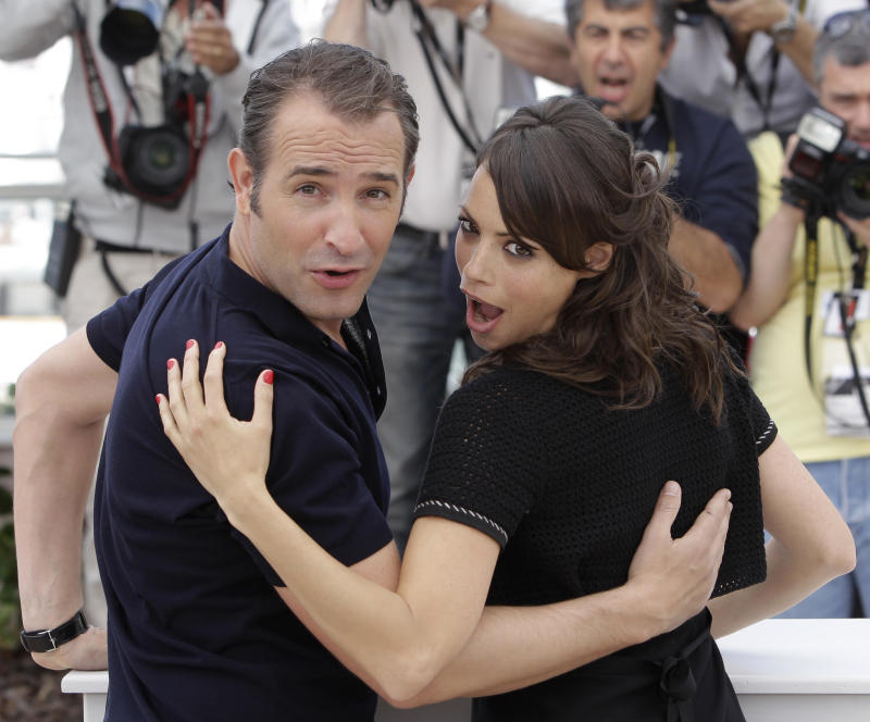 In this photo taken Sunday, May 15, 2011, actors Jean Dujardin, left, and Berenice Bejo pose during a photo call for The Artist, at the 64th international film festival, in Cannes, southern France. (AP Photo/Lionel Cironneau)