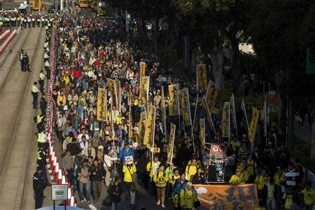 Thousands of pro-democracy protesters march in the streets to demand universal suffrage and urge Chun-ying to step down in Hong Kong