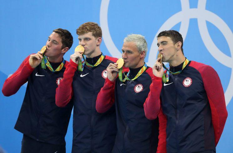 From left, Conor Dwyer, Townley Haas, Ryan Lochte and Michael Phelps from the United States celebrate winning the gold medal in the men's 4x200-meter freestyle relay during the swimming competitions at the 2016 Summer Olympics, Wednesday, Aug. 10, 2016, in Rio de Janeiro, Brazil. (AP Photo/Lee Jin-man)