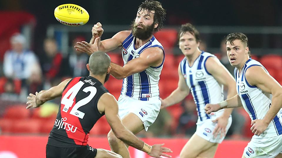 Luke McDonald, pictured here in action for North Melbourne against Essendon.