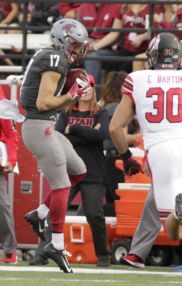 Washington State wide receiver Kyle Sweet (17) catches a pass in front of Utah linebacker Cody Barton (30) during the first half of an NCAA college football game in Pullman, Wash., Saturday, Sept. 29, 2018. (AP Photo/Young Kwak)