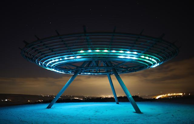 RAWTENSTALL, ENGLAND - JANUARY 15: The Haslingden Halo Panopticon illuminates the snow covered ground on January 15, 2013 in Rawtenstall, England. The installation designed by John Kennedy of LandLab sits on a hill called Top o' Slate, a reclaimed landfill site in East Lancashire and has become a major landmark since opening in 2011. 'Halo' is the centrepiece of panopticons art projects, led by the REMADE in Lancashire programme, Groundwork and Rossendale Council, which has reclaimed and returned to public use 33 hectares of land. (Photo by Christopher Furlong/Getty Images)