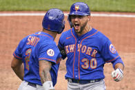 New York Mets' Michael Conforto (30) and Dominic Smith (2) celebrate as they return to the dugout after scoring on Corforto's two-run home run off Pittsburgh Pirates relief pitcher Richard Rodriguez during the ninth inning of a baseball game in Pittsburgh, Sunday, July 18, 2021. (AP Photo/Gene J. Puskar)