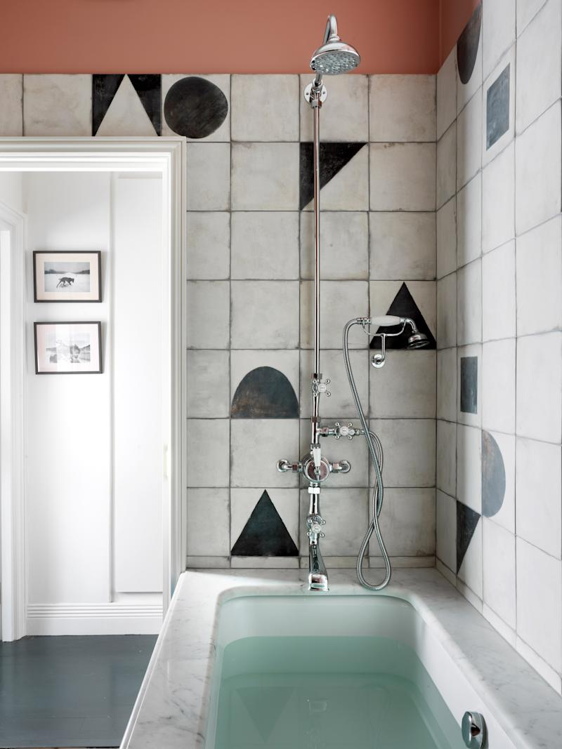 The geometric porcelain tiles feature a worn-in charm, despite being brand-new, and can be combined in a number of patterns for an innovative design.