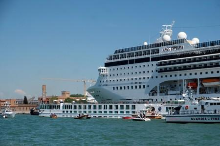 FILE PHOTO: The cruise ship MSC Opera loses control and crashes against a smaller tourist boat at the San Basilio dock in Venice