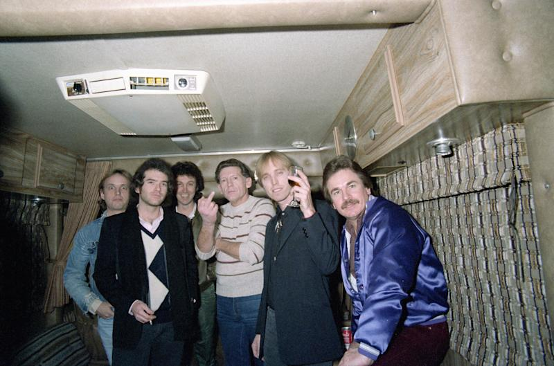 Jerry Lee Lewis greets guests, including Tom Petty, in his trailer on Jan. 17, 1984 after his concert at the Palomino in Los Angeles, CA.