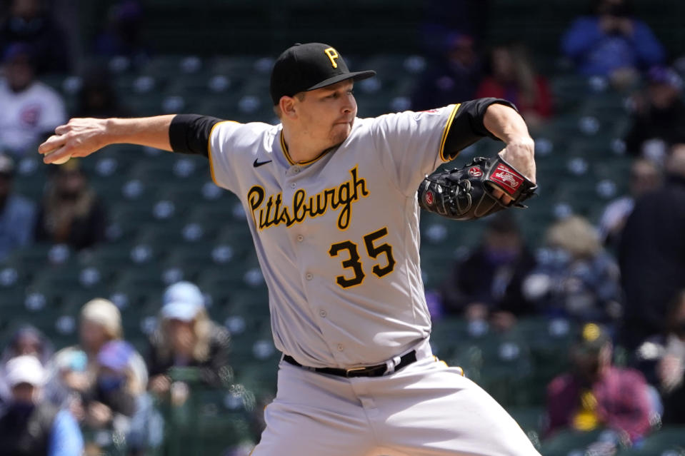 Pittsburgh Pirates starting pitcher Trevor Cahill delivers during the first inning of a baseball game against the Chicago Cubs Friday, May 7, 2021, in Chicago. (AP Photo/Charles Rex Arbogast)
