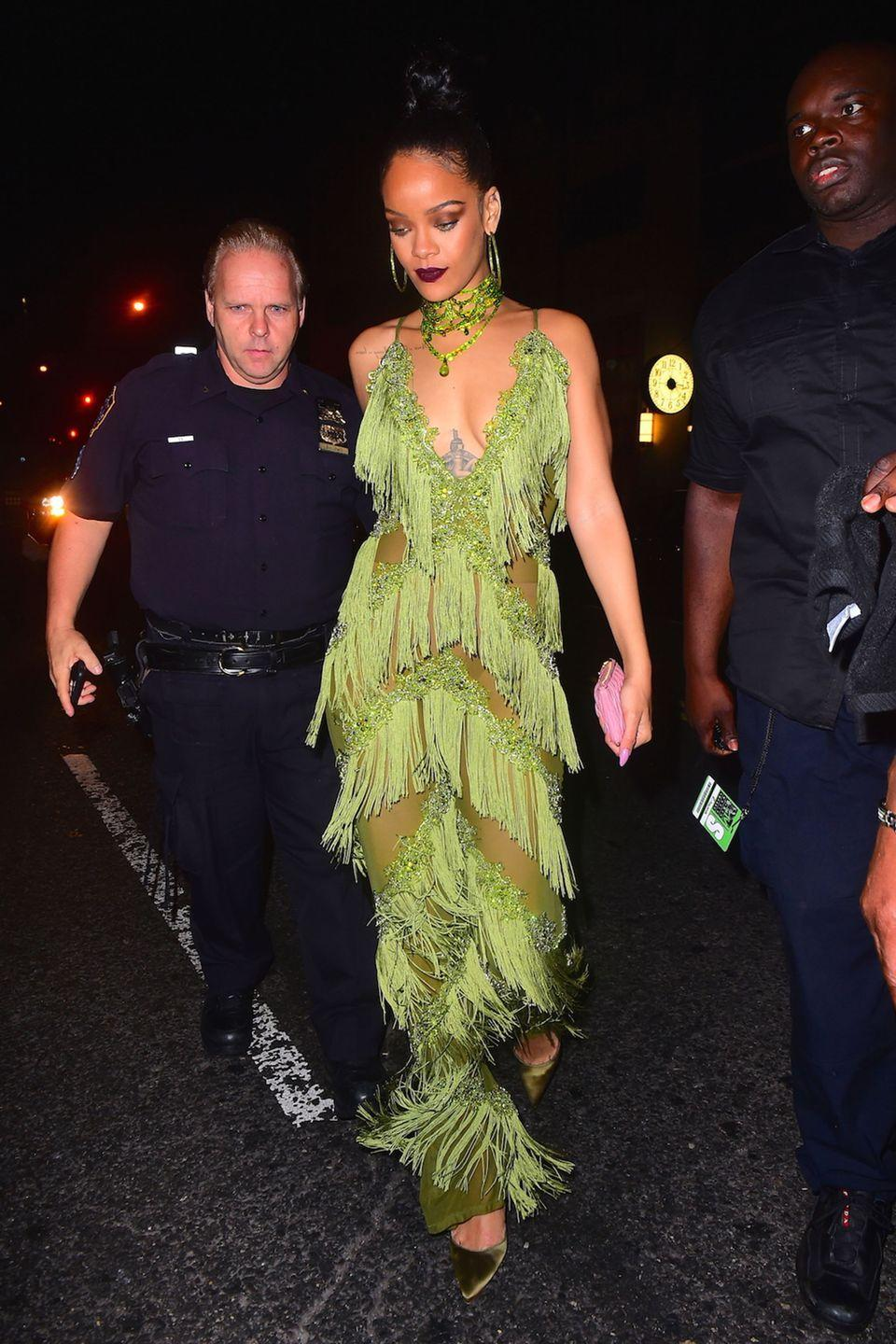 "<p>Fresh off her Vanguard Award win, four performances and <a href=""https://www.harpersbazaar.com/fashion/trends/a17382/rihanna-outfits-mtv-vmas-2016/"" rel=""nofollow noopener"" target=""_blank"" data-ylk=""slk:quadruple costume changes"" class=""link rapid-noclick-resp"">quadruple costume changes</a> at the VMAs, Rihanna stepped out to party in a fringed green jumpsuit and matching accessories in the lime hue, from her hoop earrings and choker necklace to the velvety pumps on her feet.</p>"