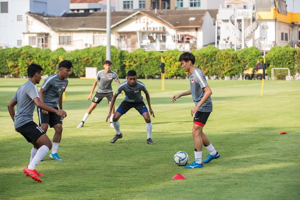 Singapore footballers training in a group. In Phase 3, the group size can be increased from five to eight.