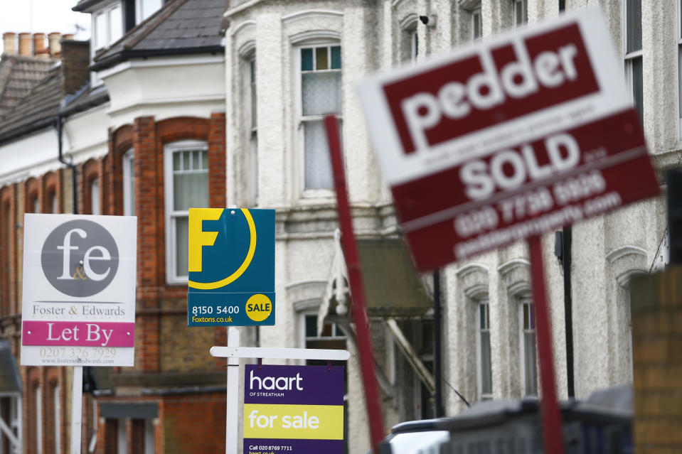 Estate agents boards are lined up outside houses in south London June 3, 2014. Britain's house prices rose at their fastest annual pace in nearly seven years last month and signs of bottlenecks in the construction sector underscored the upward pressures on the market, surveys showed on Tuesday. House price growth picked up to an annual pace of 11.1 percent in May, mortgage lender Nationwide said, fanning concerns that the property market could be overheating.  REUTERS/Andrew Winning   (BRITAIN - Tags: POLITICS BUSINESS REAL ESTATE)