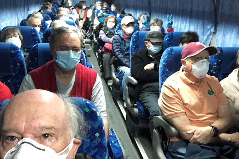 US passengers of the Diamond Princess cruise ship are transported by shuttle bus in Yokohama to Haneda airport to fly home on a chartered evacuation flight (via REUTERS)