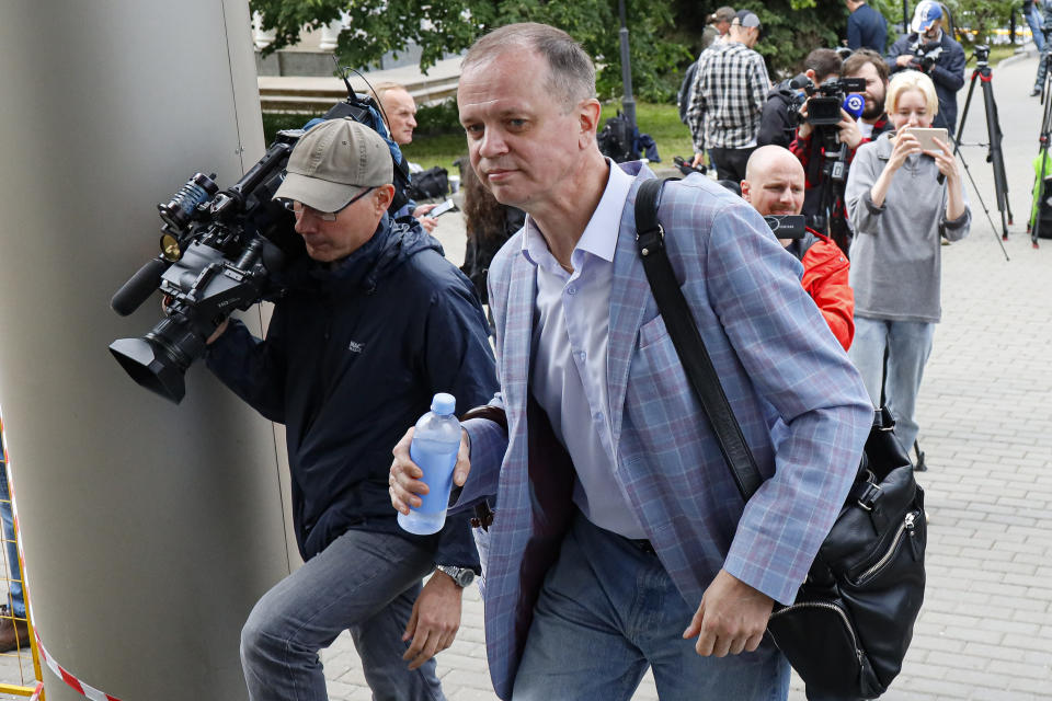 """FILE - In this Wednesday, June 9, 2021 file photo, Russian lawyer Ivan Pavlov arrives to attend a court session after speaking to the media at Moscow Court, in Moscow, Russia. A rights group in Russia announced Sunday July 18, 2021, that it was shutting down, citing fear of prosecution of its members and supporters after Russian authorities blocked its website for allegedly publishing content from an """"undesirable"""" organization. The Team 29 association of lawyers and journalists specializing in treason and espionage cases and freedom of information issues said Sunday that Russian authorities accused it of spreading content from a Czech non-governmental organization that had been declared """"undesirable"""" in Russia. (AP Photo/Alexander Zemlianichenko, File)"""