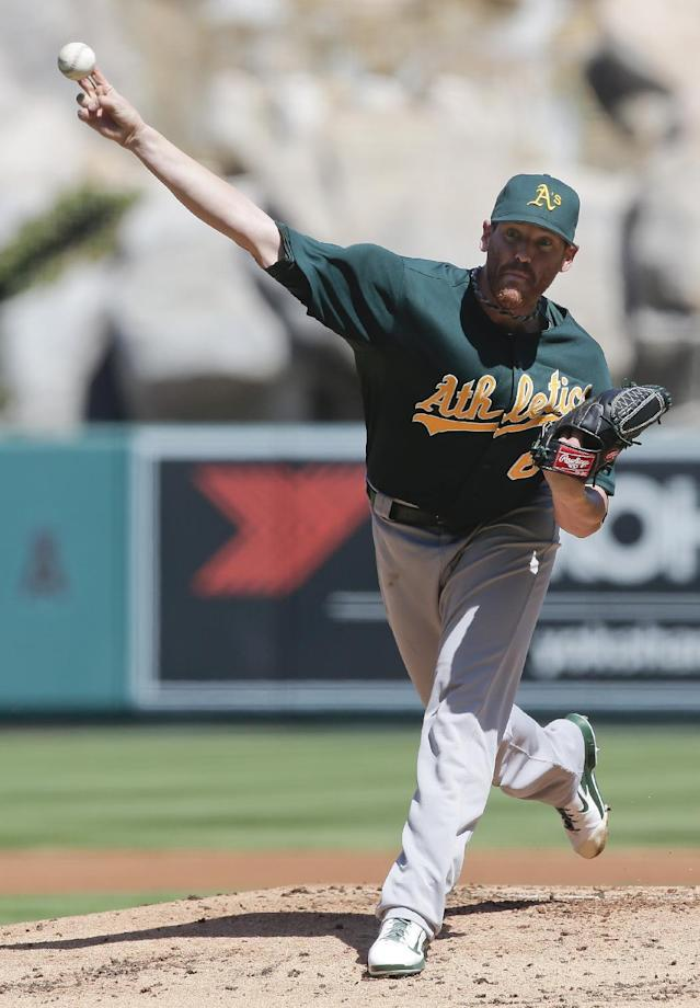 Oakland Athletics starting pitcher Dan Straily throws to the Los Angeles Angels during the first inning of a baseball game in Anaheim, Calif., Wednesday, Sept. 25, 2013. (AP Photo/Chris Carlson)