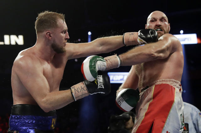 Otto Wallin, left, of Sweden, punches Tyson Fury, of England, during their heavyweight boxing match Saturday, Sept. 14, 2019, in Las Vegas. (AP Photo/Isaac Brekken)