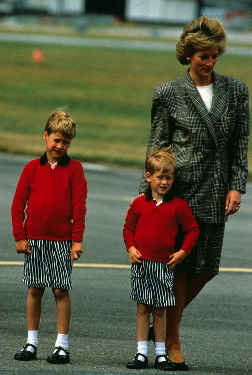 <p>With her boys in matching outfits, at Aberdeen Airport as they kick off yet another family holiday in Scotland.</p>