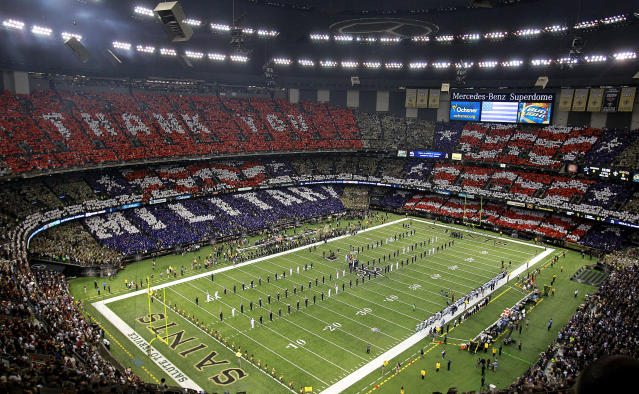 IN THIS IMAGE DISTRIBUTED BY AP IMAGES FOR USAA - An overall inside view of the Mercedes-Benz Superdome as fans honor military and veterans before a NFL game between the Dallas Cowboys and the New Orleans Saints, Sunday, November 10, 2013 in New Orleans. 50,000 cards were provided to fans by USAA, the official military appreciation sponsor of the NFL. (Sean Gardner/AP Images for USAA)