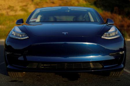 FILE PHOTO: A 2018 Tesla Model 3 electric vehicle is shown in this photo illustration taken in Cardiff, California, U.S., June 1, 2018. REUTERS/Mike Blake/File Photo