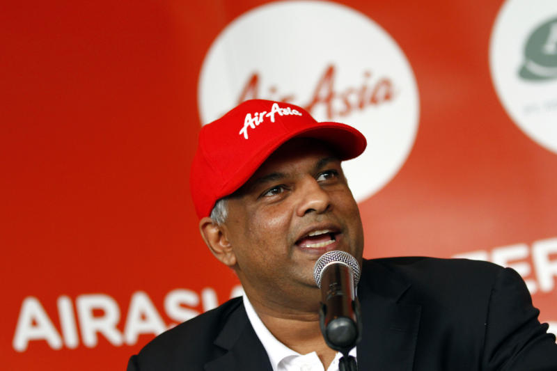 AirAsia Chief Executive Officer Tony Fernandez speaks during a joint press conference with Batavia Air President Director Yudiawan Tansari, unseen, in Jakarta, Indonesia, Thursday, July 26, 2012. Low-cost airline AirAsia said it is buying Indonesian budget carrier Batavia Air to expand in Southeast Asia's biggest economy. (AP Photo/Achmad Ibrahim)