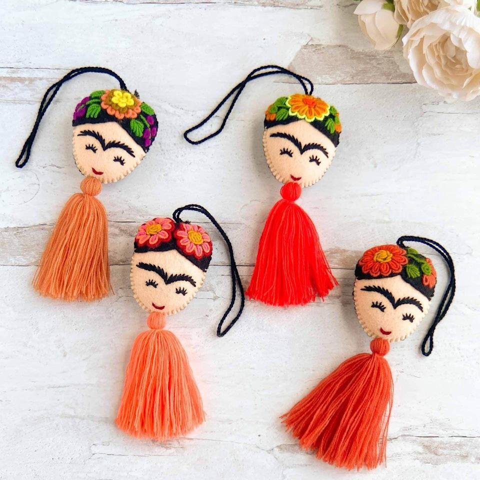 "<p><strong>Xula Handmade</strong></p><p>xulahandmade.com</p><p><strong>$18.00</strong></p><p><a href=""https://xulahandmade.com/collections/tassels-pom-poms/products/embroidered-frida-tassels-orange"" rel=""nofollow noopener"" target=""_blank"" data-ylk=""slk:Shop Now"" class=""link rapid-noclick-resp"">Shop Now</a></p><p>It's my personal opinion that every Christmas tree could use a little extra Frida Kahlo. </p>"