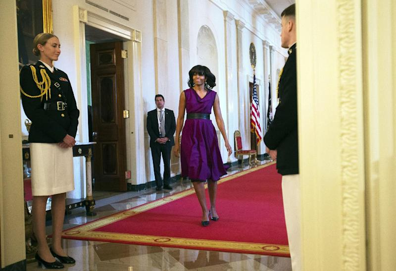 First lady Michelle Obama arrives at a ceremony to award the 2013 National Medals for Museum and Library Service in the East Room of the White House in Washington, Wednesday, May 8, 2013. (AP Photo/Jacquelyn Martin)