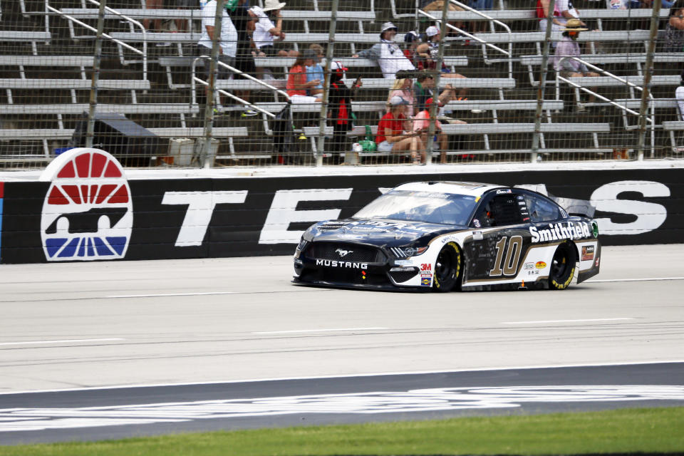 Aric Almirola's car is seen heading down the front stretch.