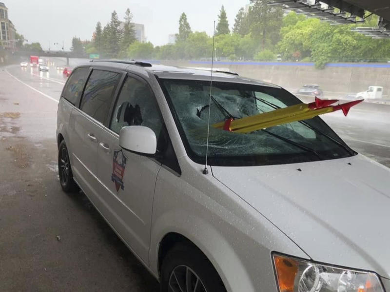 In this Thursday, May 16, 2019, photo released by El Dorado Veterans Resources Transportation/Military Family Support Group (MFSG) shows a stolen tripod from a California Department of Transportation crew, that was dropped from an overpass onto a Sacramento freeway, impaling the lung of a passenger riding on a El Dorado Veterans Resources, van in Sacramento, Calif. The driver of the van, Tim Page, tells KCRA-TV that he was on Interstate 5 Thursday morning when the yellow-and-red tripod smashed through the glass. The passenger survived but with broken ribs and a partially punctured lung. (Tim Page/El Dorado Veterans Resources Transportation/Military Family Support Group via AP)