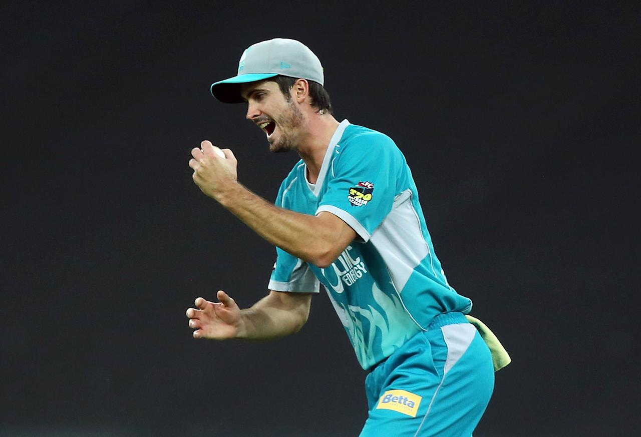 SYDNEY, AUSTRALIA - DECEMBER 28:  Ben Cutting of the Heat celebrates taking a catch to dismiss Sean Abbott of the Heat during the Big Bash League match between the Sydney Thunder and the Brisbane Heat at ANZ Stadium on December 28, 2012 in Sydney, Australia.  (Photo by Mark Metcalfe/Getty Images)