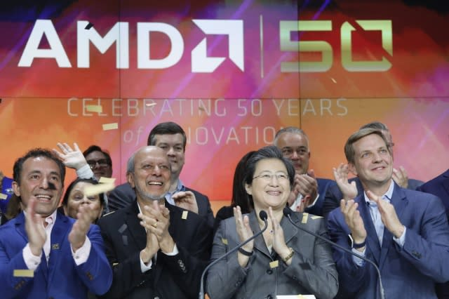 Lisa Su, second from right, president and CEO of AMD, attends the opening bell at Nasdaq, Wednesday, May 1, 2019, in New York. Advanced Micro Devices is celebrating its 50th anniversary. (AP Photo/Mark Lennihan)