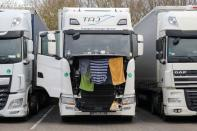 Clothes and towels hang to dry on a lorry at Ashford International Truck Stop