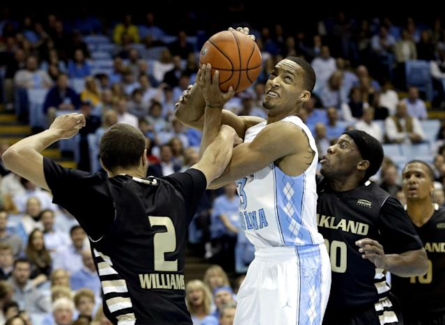 North Carolina's J.P. Tokoto, center, struggles for possession of the ball with Oakland's Dante Williams (2) and Kahlil Felder, front right, during the first half of an NCAA college basketball game in Chapel Hill, N.C., Friday, Nov. 8, 2013. (AP Photo/Gerry Broome)
