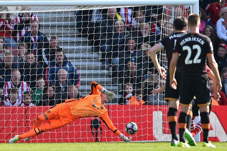 Hull City's goalkeeper Eldin Jakupovic dives to save the penalty kick taken by Southampton's Dusan Tadic during their English Premier League football match at St Mary's Stadium in Southampton, southern England on April 29, 2017