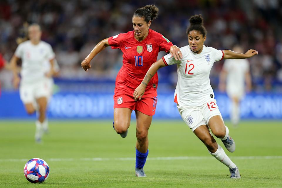 LYON, FRANCE - JULY 02: Carli Lloyd of the USA battles for possession with Demi Stokes of England during the 2019 FIFA Women's World Cup France Semi Final match between England and USA at Stade de Lyon on July 02, 2019 in Lyon, France. (Photo by Maddie Meyer - FIFA/FIFA via Getty Images)
