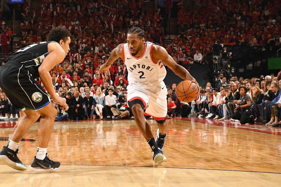 TORONTO, CANADA - MAY 25: Kawhi Leonard #2 of the Toronto Raptors handles the ball during the game against Malcolm Brogdon #13 of the Milwaukee Bucks during Game Six of the Eastern Conference Finals on May 25, 2019 at Scotiabank Arena in Toronto, Ontario, Canada. NOTE TO USER: User expressly acknowledges and agrees that, by downloading and/or using this photograph, user is consenting to the terms and conditions of the Getty Images License Agreement. Mandatory Copyright Notice: Copyright 2019 NBAE (Photo by Ron Turenne/NBAE via Getty Images)