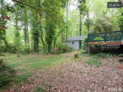 <p>A large but overgrown and uninviting backyard. </p>