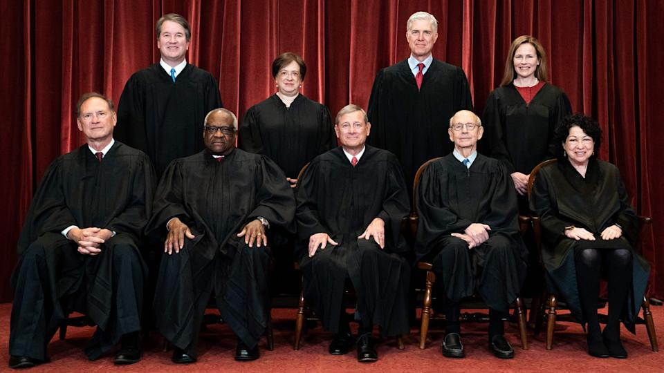 Seated from left: Associate Justice Samuel Alito, Associate Justice Clarence Thomas, Chief Justice John Roberts, Associate Justice Stephen Breyer and Associate Justice Sonia Sotomayor, standing from left: Associate Justice Brett Kavanaugh, Associate Justice Elena Kagan, Associate Justice Neil Gorsuch and Associate Justice Amy Coney Barrett pose during a group photo of the Justices at the Supreme Court in Washington, DC on April 23, 2021. (Photo by Erin Schaff / POOL / AFP) (Photo by ERIN SCHAFF/POOL/AFP via Getty Images)