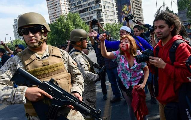 Soldiers were deployed in the streets for the first time since Chile returned to democracy in 1990 (AFP Photo/Martin BERNETTI)