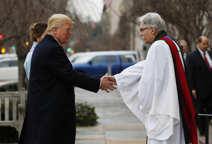 <p>Rev. Luis Leon greets President-elect Donald Trump and his wife Melania as they arrive for a church service at St. John's Episcopal Church across from the White House in Washington, Friday, Jan. 20, 2017, on Donald Trump's inauguration day. (Photo: Alex Brandon/AP) </p>