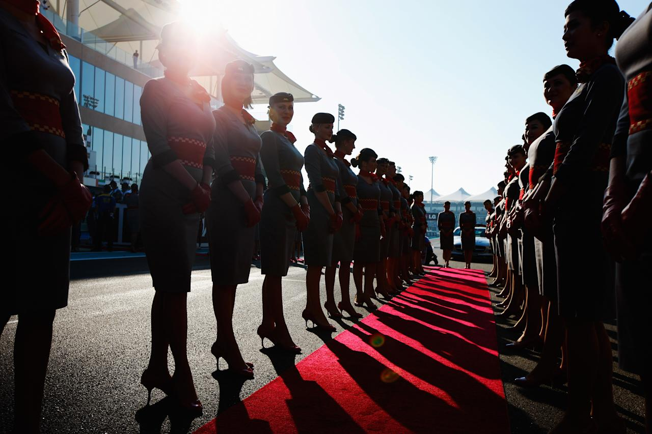 ABU DHABI, UNITED ARAB EMIRATES - NOVEMBER 13:  Grid girls line up before the drivers parade during the Abu Dhabi Formula One Grand Prix at the Yas Marina Circuit on November 13, 2011 in Abu Dhabi, United Arab Emirates.  (Photo by Mark Thompson/Getty Images)