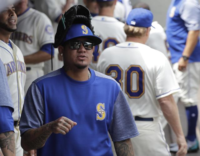 Seattle Mariners pitcher Felix Hernandez wears his glove on his head as he walks in the dugout before a baseball game against the Colorado Rockies, Sunday, July 8, 2018, in Seattle. (AP Photo/Ted S. Warren)