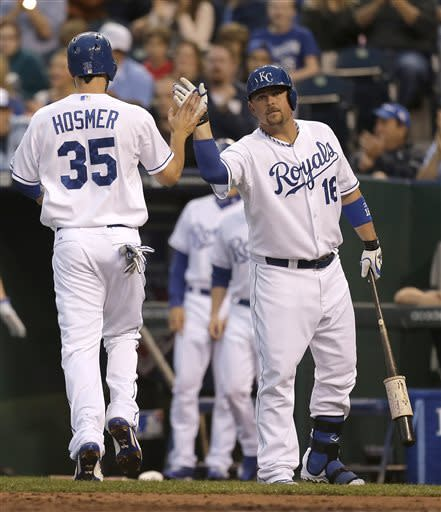 Kansas City Royals' Eric Hosmer (35) celebrates with Billy Butler after scoring on a single by Salvador Perez during the first inning of a baseball game Wednesday, June 5, 2013, in Kansas City, Mo. (AP Photo/Charlie Riedel)