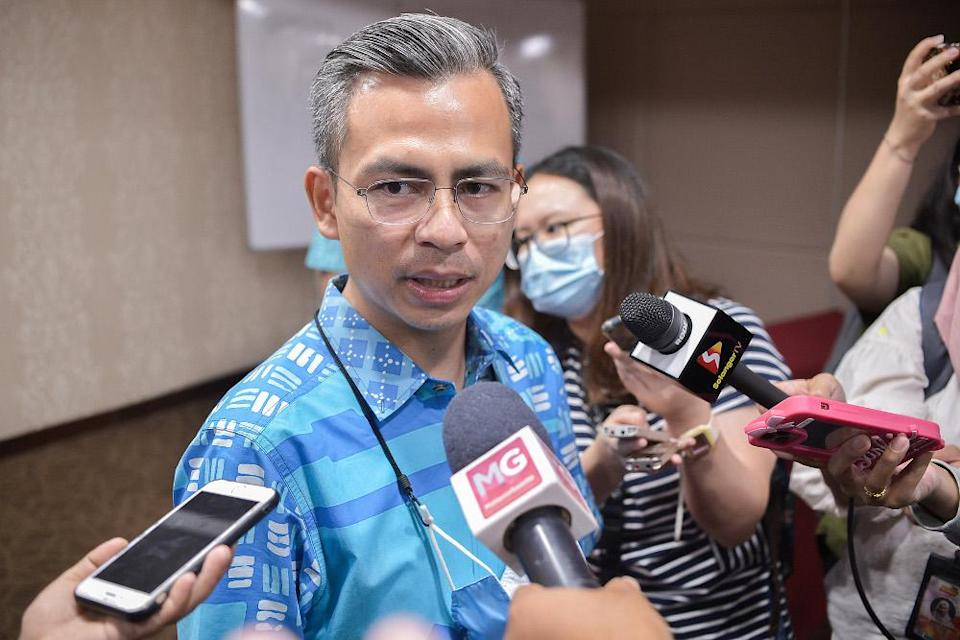 Fahmi Fadzil speaks said Selangor Mentri Besar Amirudin Shari and Selangor exco Hee Loy Sian — both PKR members — had explained to the party's political bureau during a meeting last night that the decision will be postponed until all issues that have been raised is clarified. — Picture by Miera Zulyana