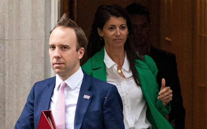Matt Hancock leaves 10 Downing Street with aide Gina Coladangelo - Getty