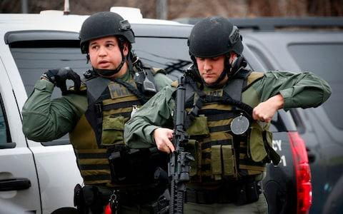 A shooting in a New York suburb not far from the Statue of Liberty left a police officer dead - Credit: KENA BETANCUR/AFP