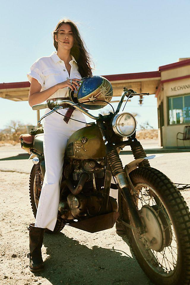 """<em>Shop <strong><a href=""""https://www.freepeople.com/"""" rel=""""nofollow noopener"""" target=""""_blank"""" data-ylk=""""slk:Free People"""" class=""""link rapid-noclick-resp"""">Free People</a></strong></em><br><br><strong>We The Free</strong> Marci Coverall, $, available at <a href=""""https://go.skimresources.com/?id=30283X879131&url=https%3A%2F%2Fwww.freepeople.com%2Fshop%2Fmarci-coverall%2F%3Fcategory%3Djumpsuits-rompers%26color%3D010%26type%3DREGULAR%26quantity%3D1"""" rel=""""nofollow noopener"""" target=""""_blank"""" data-ylk=""""slk:Free People"""" class=""""link rapid-noclick-resp"""">Free People</a>"""