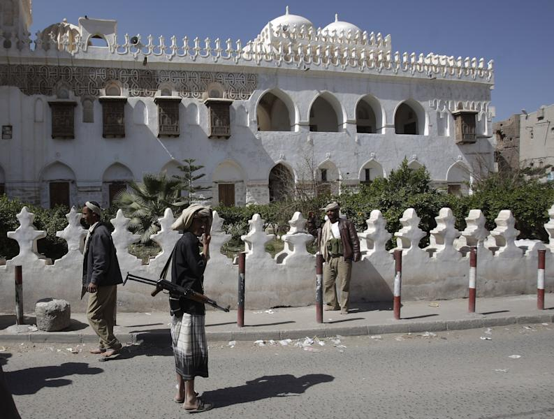 FILE - In this Wednesday, Jan. 25, 2012 file photo, Yemeni armed tribesmen stand guard in front of Ameriyah religious school which was seized by al-Qaida militant in Radda town, 100 miles (160 kilometers) south of the capital Sanaa, Yemen. After years of stalling under its now-ousted leader, Yemen is finally showing resolve in the fight against al-Qaida, aided by the United States, which just scored an intelligence coup by breaking up a new bomb plot there. (AP Photo/Hani Mohammed, File)