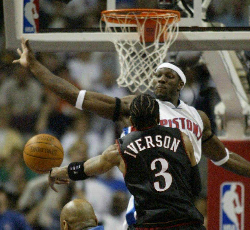 76ers' Allen Iverson runs into the defense of Pistons' Ben Wallace during the second half in Game 2 of the Eastern Conference semifinals at the Palace of Auburn Hills, May 8, 2003.