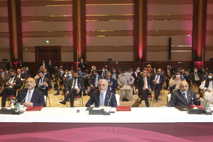 Abdullah Abdullah, center, chairman of Afghanistan's High Council for National Reconciliation, attends the opening session of the peace talks between the Afghan government and the Taliban in Doha, Qatar, Saturday, Sept. 12, 2020. (AP Photo/ Hussein Sayed)